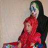Photo #2 - Scary Clown Carrying Jester