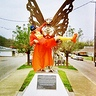 Photo #2 - Squirtman being carried by mothman statue