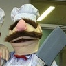 Photo #4 - The Swedish Chef brandishing his giant cleaver