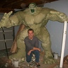Photo #4 - Day 19: 'Monster mud' was added to paper mache to strengthen the armature. (MM is five parts dry wall putty one part exterior latex paint. In this case...green.)  I had placed a temporary head made of foam to give me an idea where the neck muscles will go