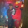 Photo #3 - I am Elmo holding  skeleton cat Pooky.