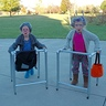 Photo #1 - Full body shot of the 2 old Granny's with their walkers