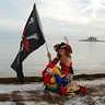 Photo #8 - A pirate and her parrot on the shore