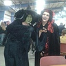 Photo #3 - on the right with the red and black wig