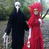 Photo #1 - The bird masked creature and red lady