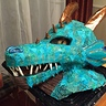 Photo #7 - Final painted head.  We used some of the same material we used for the scales and glued them on the outside of the head to make all of the scale match.  Clay was used for the teeth, spikes and nostrils.