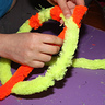 Photo #8 - Twisting Chenille Stems for Magnifying Glass