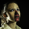 Photo #2 - Zipper Face Girl Close