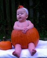Baby Girl in a Pumpkin