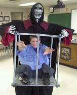 Illusion costume ideas - Boy Trapped in Cage by Monster