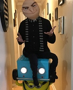 Gru in Lucy Wilde's car held by a minion Homemade Costume