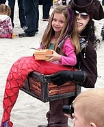 Illusion costume ideas - Mermaid Captured by a Pirate Costume