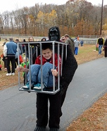 Gorilla carrying a Kid Halloween Costume