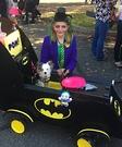 Batman in Batmobile with Joker Costume
