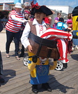Minion Carrying a Pirate Illusion Costume