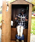 Hunter in an Outhouse Costume