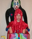 Scary Clown Carrying Jester Costume